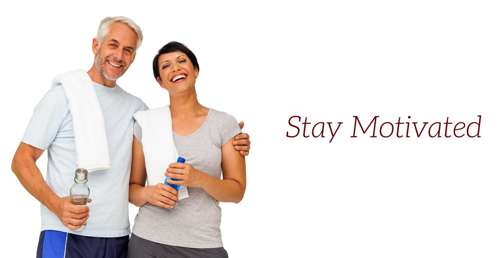 Portrait of a happy fit couple standing over white background