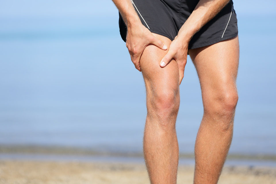 Muscle injury. Man with sprain thigh muscles